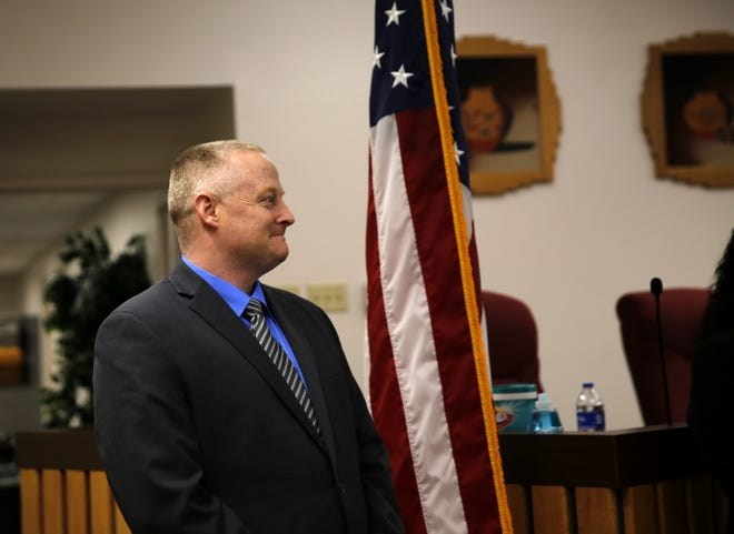 David Karst waits to be sworn in as Bloomfield's new police chief Monday at Bloomfield City Hall.