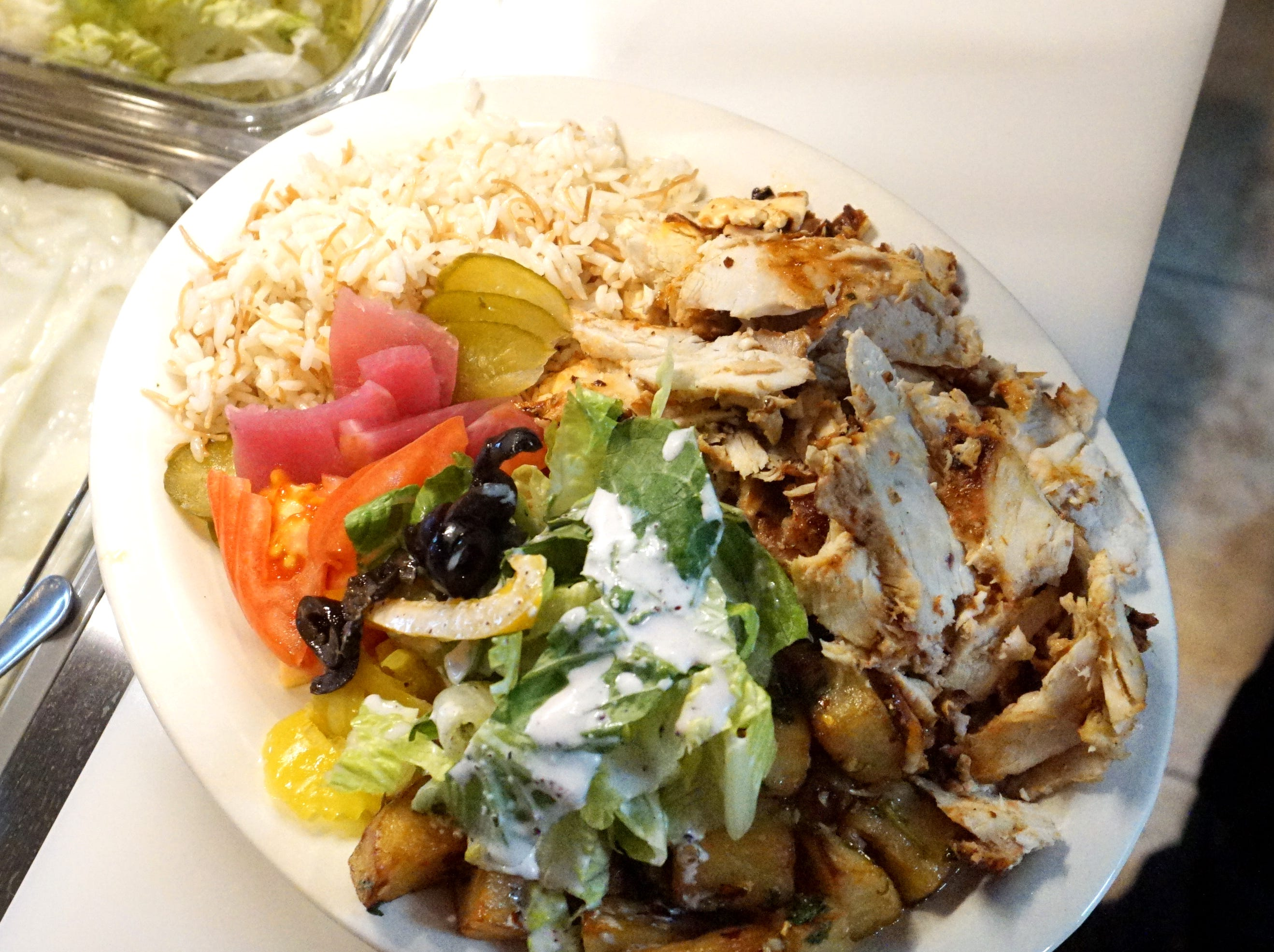 The chicken shawarma meal with rice, herbed potatoes and vegetables.