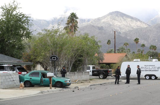 Police investigate the scene of an accident on Sunny Dunes Road in Palm Springs. The Toyota Corolla, police say, held three teens killed in the Palm Springs quadruple homicide early Sunday, Feb. 3, 2019.