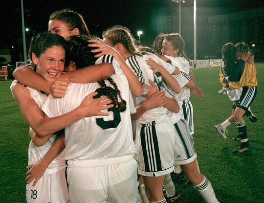 Gulf Breeze, girls soccer  team celebrates after winning the 2000 Class 2A championship  with 5-0 victory.