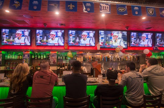 Sports fans watch the Super Bowl on Feb. 3 inside the Beef 'O' Brady's in downtown Pensacola.