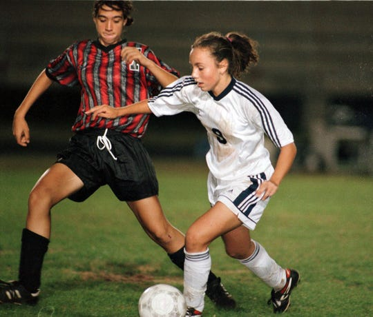 -  -11-19-98,3D Tate High School's Julie Revels tries to get the ball as Gulf Breeze High School's Gwendolyn Oxenham dribles the ball.