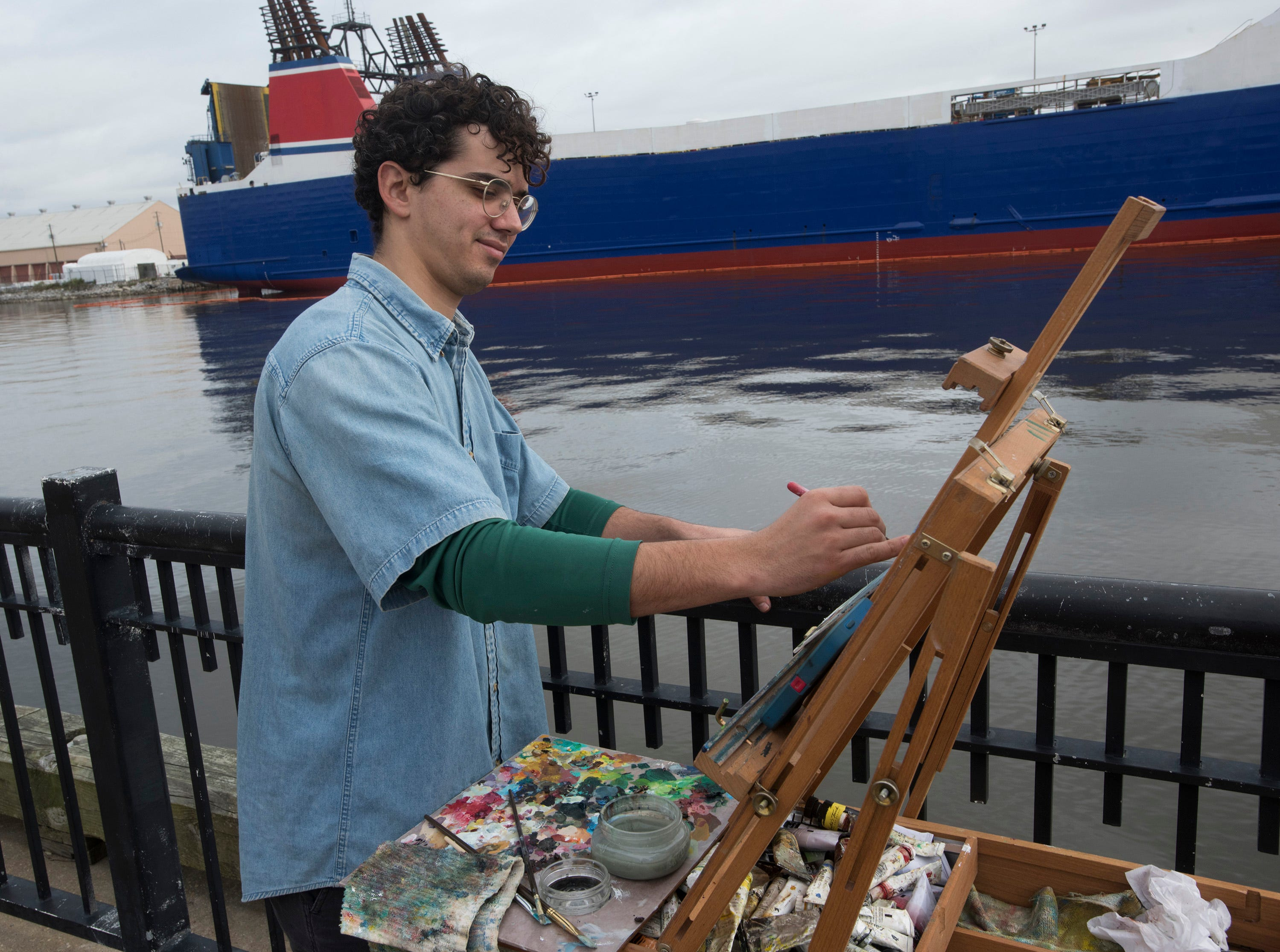 Sam Ruiz paints the tall ship Lynx docked in Pensacola on Monday, Feb. 4, 2019. The recreation of a 19th-century schooner is back in Pensacola and moored at Plaza de Luna. The living history museum will be in City of Five Flags offering tours to the public through March 11.
