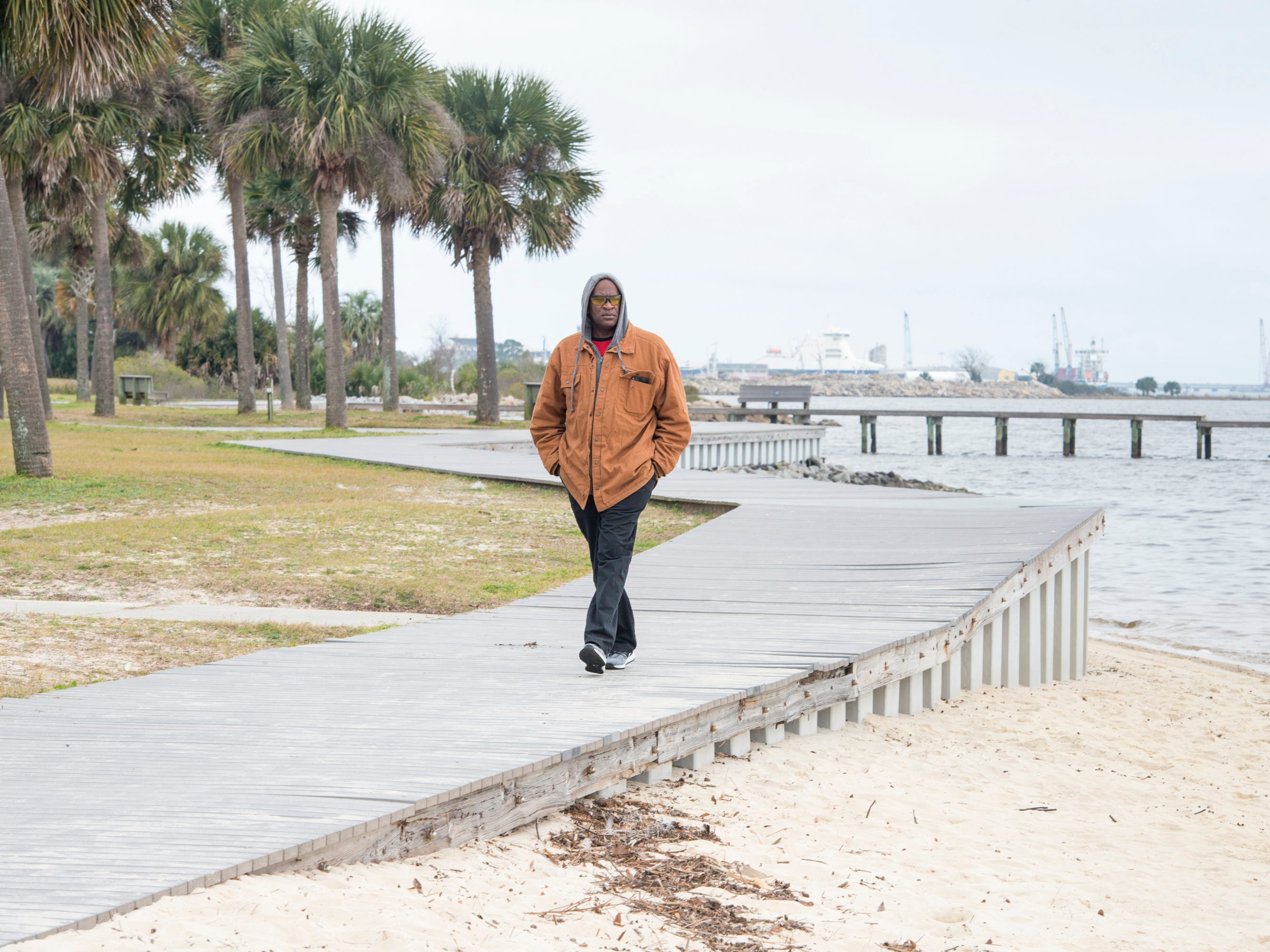 Joe Wilson walks along the boardwalk at Sanders Beach in Pensacola on Monday, February 4, 2019.  Pensacola Mayor Grover Robinson plans to ask the Pensacola City Council for $60,000 to have the landscape architecture firm SCAPE study ways to improvement access, connectivity and resiliency along the waterfront between Joe Patti's Seafood to Bayou Chico. If approved, the funding would extend the boundaries of an existing SCAPE funded by Pensacola entrepreneur and philanthropist Quint Studer.
