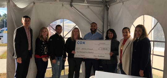 AMI Kids of Pensacola received $2,500 from Cox to assist their program serving Escambia County students.