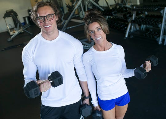 Matt Hoodie (left) and his wife Becky Hoodie (right) stand for a portrait in they gym Transform in Scottsdale, Ariz. on Friday, Feb. 1 2019. The Hoodie's run a personal training program aimed at helping obese people lose and maintain their weight.