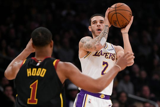 Lakers point guard Lonzo Ball looks to shoot over Cavaliers guard Rodney Hood during a game Jan. 13 at Staples Center.