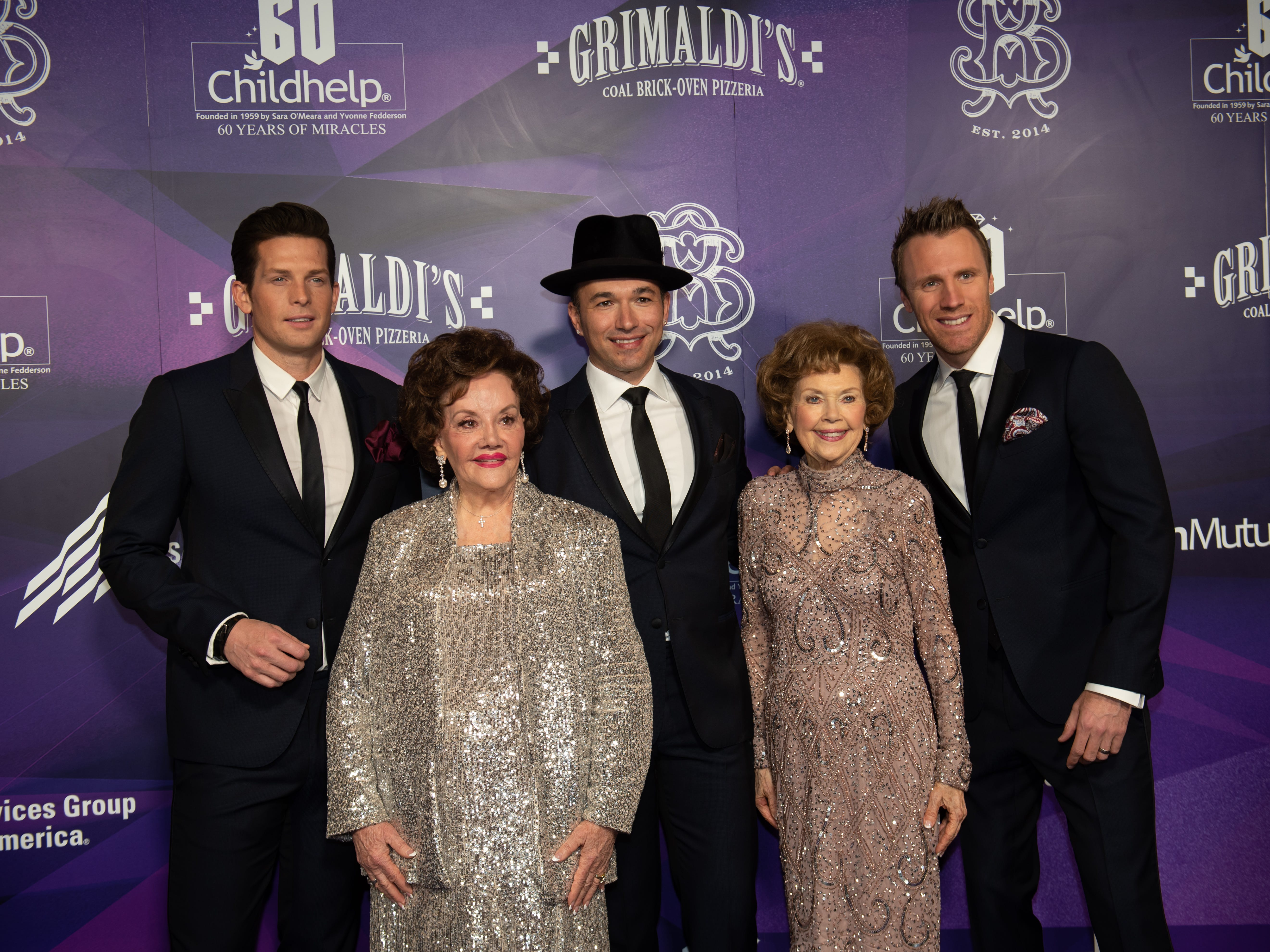 The Tenors accompanied by Childhelp Co-Founders Sara O'Meara (center) and Yvonne Fedderson attended the Childhelp Drive the Dream Gala on February 2, 2019.