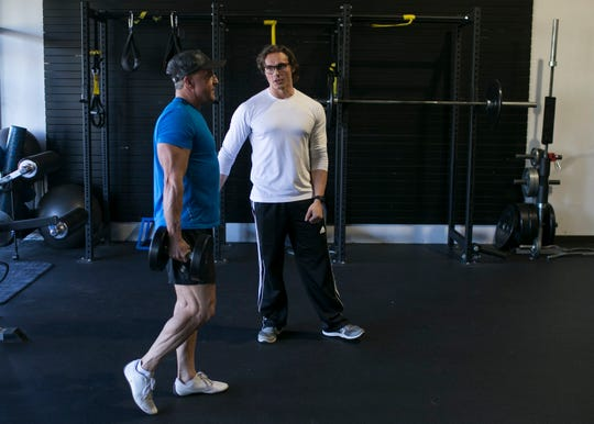 Matt Hoodie (right) trains Guy Brittain (left) at Hoodie and his wife Becky's gym Transform in Scottsdale, Ariz. on Friday, Feb. 1 2019. The Hoodie's run a personal training program aimed at helping obese people lose and maintain their weight.