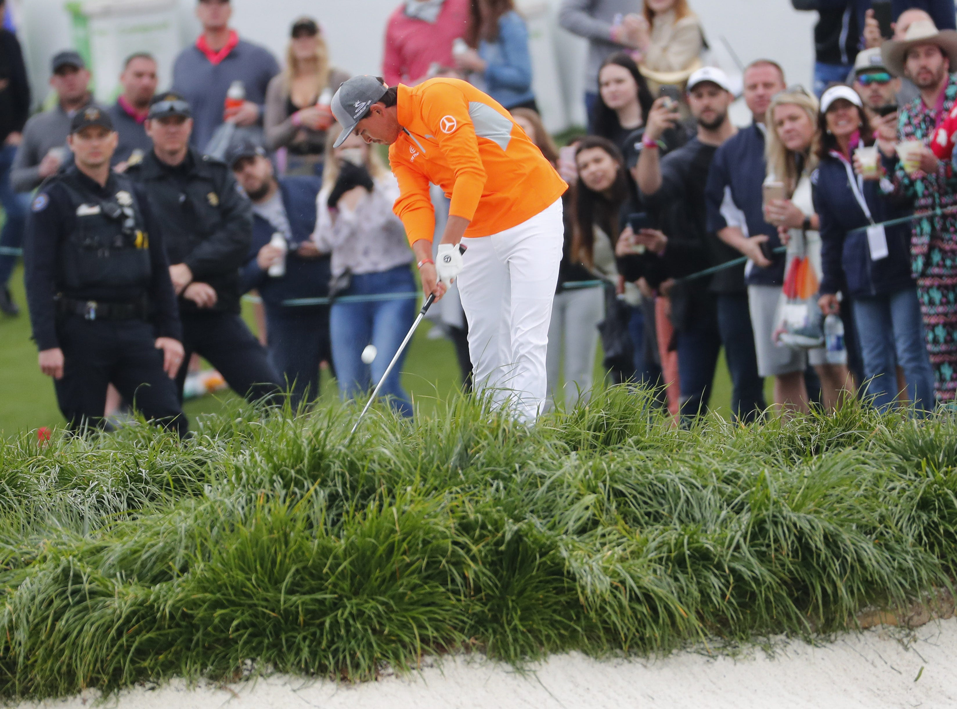 Rickie Fowler hits his second shot on the 18th hole during the final round of the Waste Management Phoenix Open at the TPC Scottsdale Feb. 3, 2019.