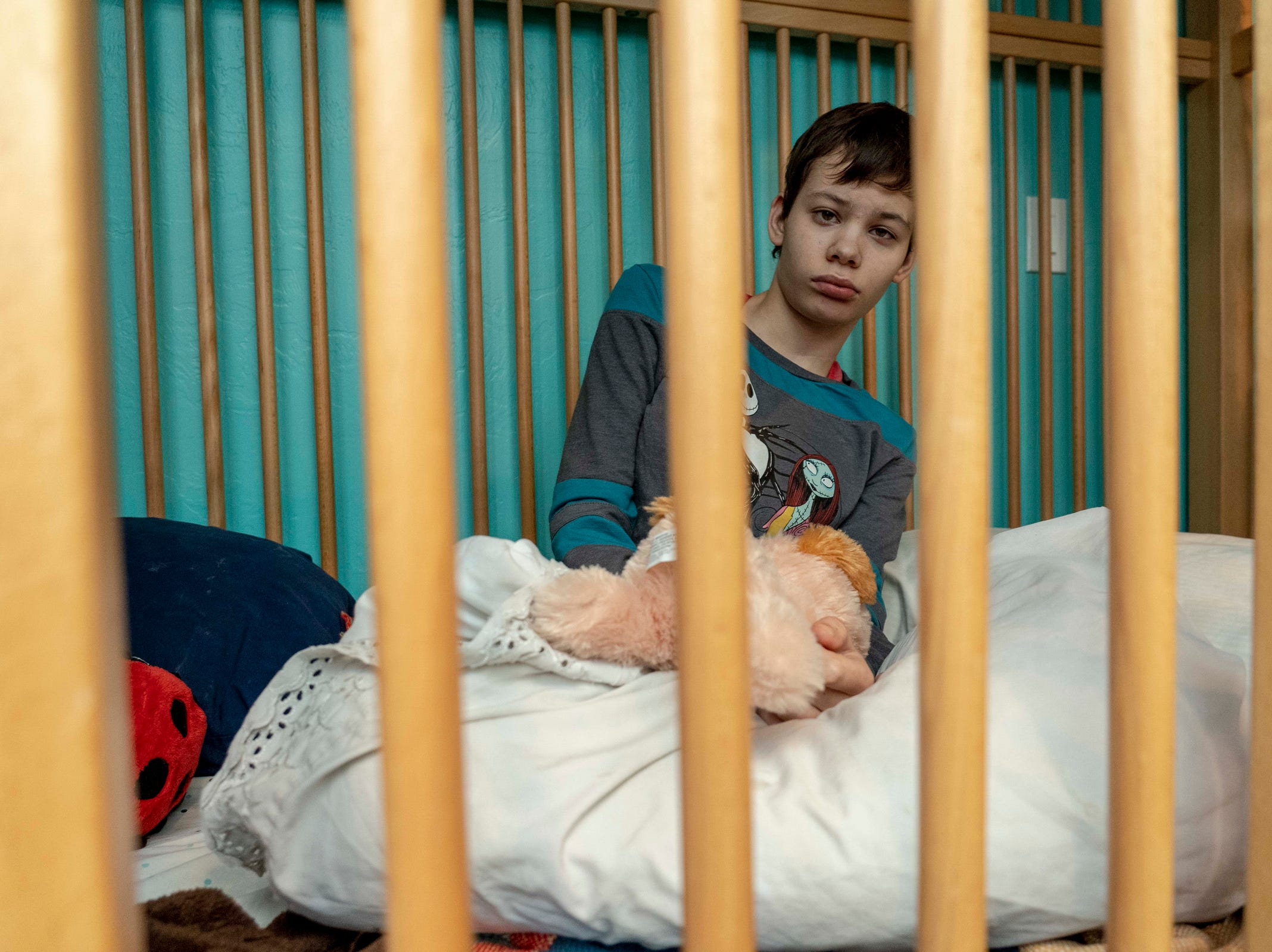 Fifteen-year-old Julianna Wadsack of Tucson sits in a KayserBettern bed, a durable piece of medical equipment designed to provide a safe environment for people with neurodevelopmental disorders and obtained through a medical prescription.