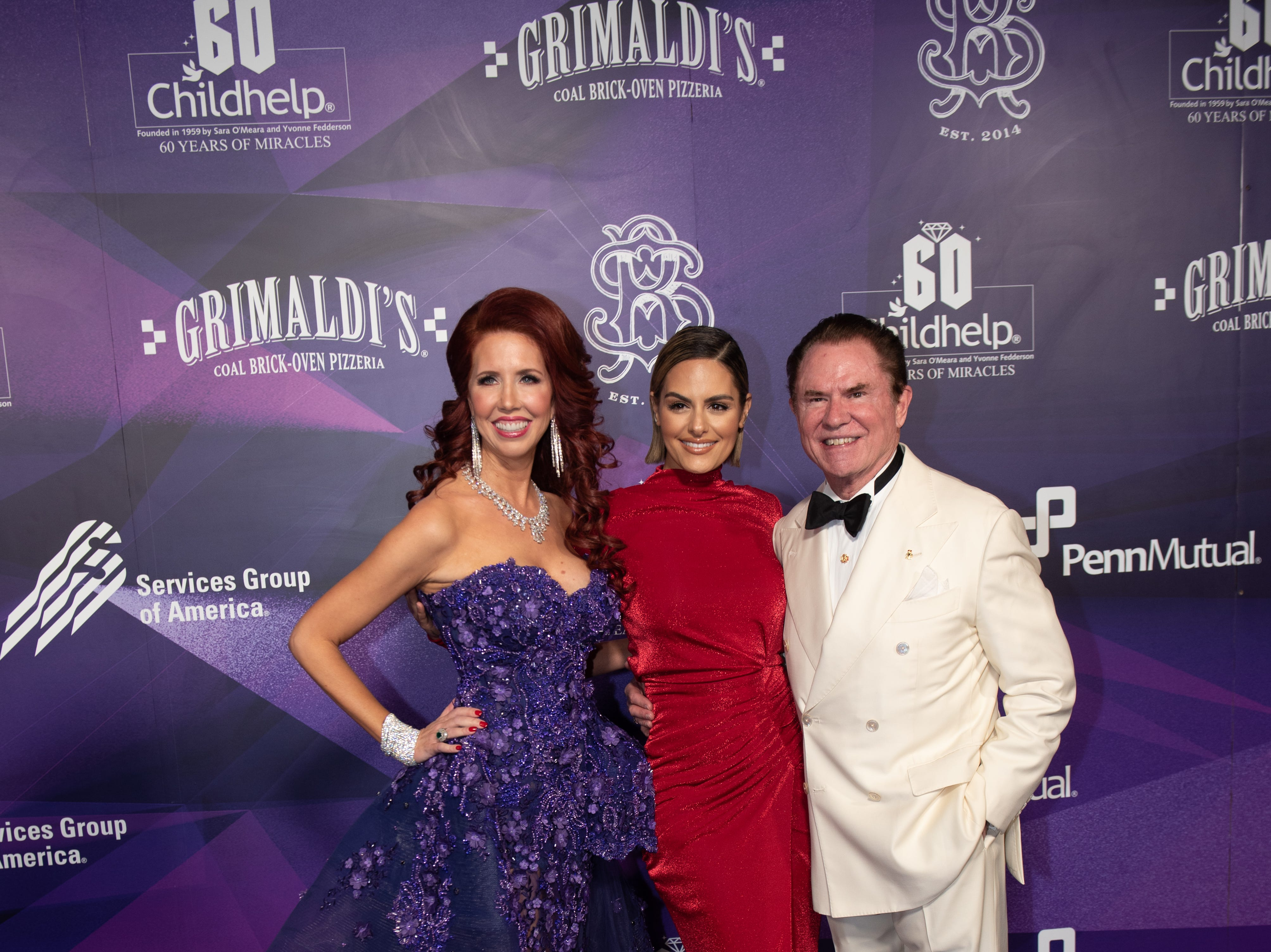 Gala Co-Chair Stacie J. Stephenson, vocalist Pia Toscano (center), and Gala Co-Chair Mr. Richard J. Stephenson attended the Childhelp Drive the Dream Gala on February 2, 2019.