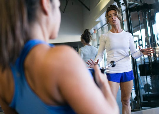 Becky Hoodie (right) trains Libertie Santalucia (left) at Hoodie and her husband Matt's gym Transform in Scottsdale, Ariz. on Friday, Feb. 1 2019. The Hoodie's run a personal training program aimed at helping obese people lose and maintain their weight.