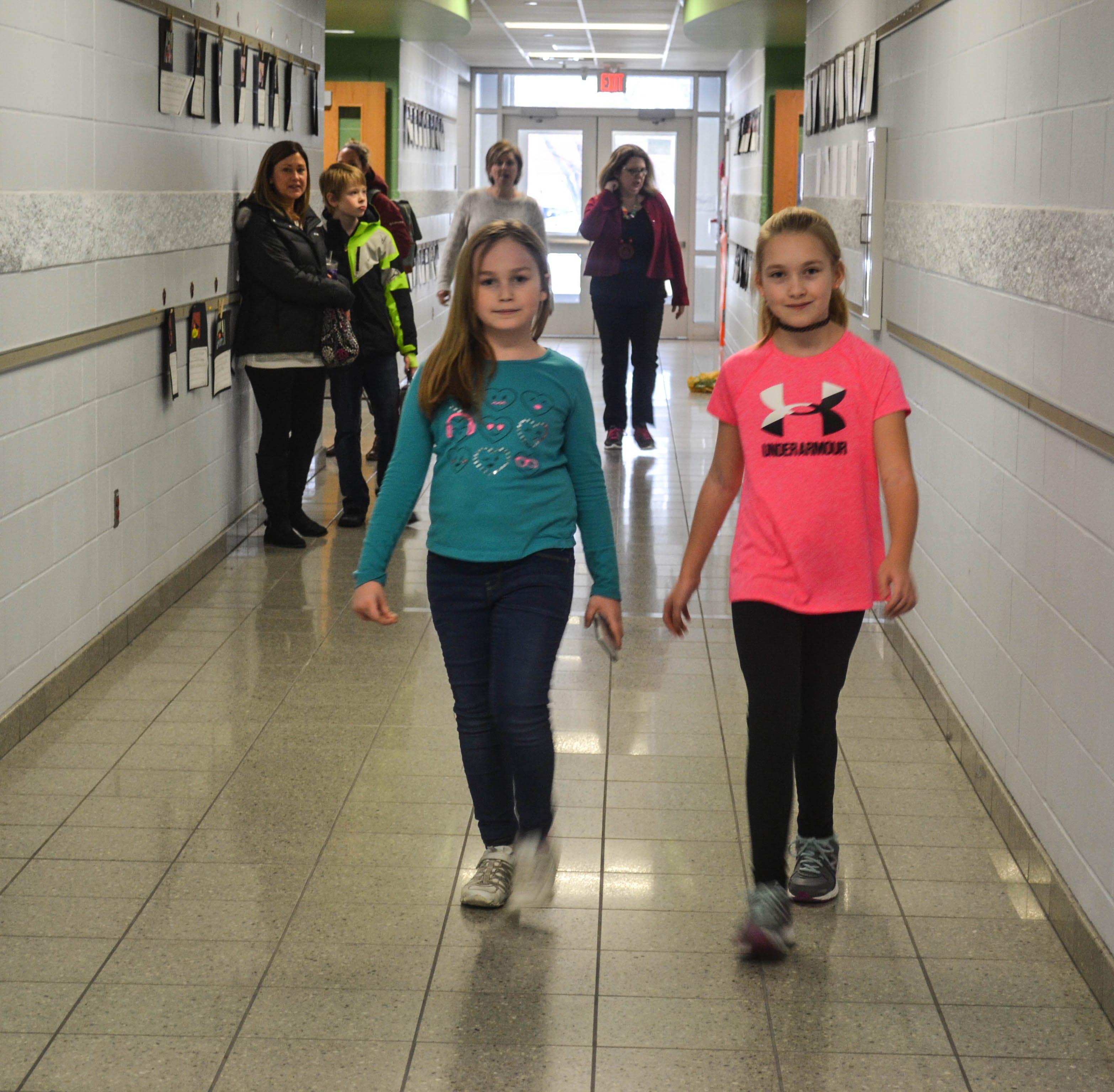 Kids, teachers hoof the halls of Woodmore elementary for Walking Club