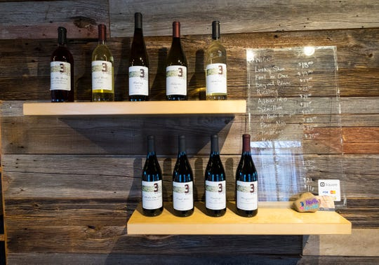 Bottles of different wines for sale line a shelf at 3 North Vines in Croswell. A new partnership across Huron, Tuscola and Sanilac Counties is looking to bring more breweries, wineries and similar businesses to the area.