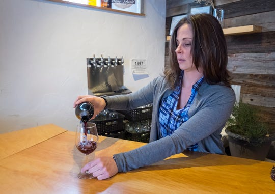 Kristi Shopbell, owner of 3 North Vines in Peck, pours a glass of wine Monday, Feb. 4, 2019 at the winery. A new partnership across Huron, Tuscola and Sanilac Counties is looking to bring more breweries, wineries and similar businesses to the area.