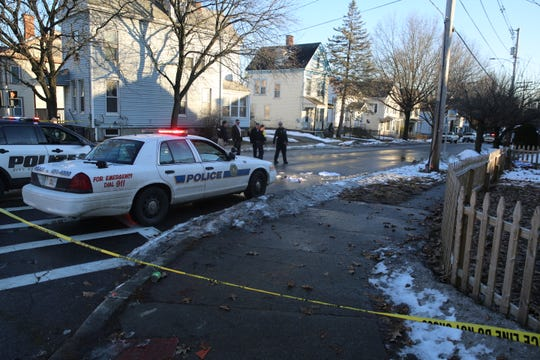 City of Poughkeepsie Police investigate a crime scene on South Cherry Street Monday.