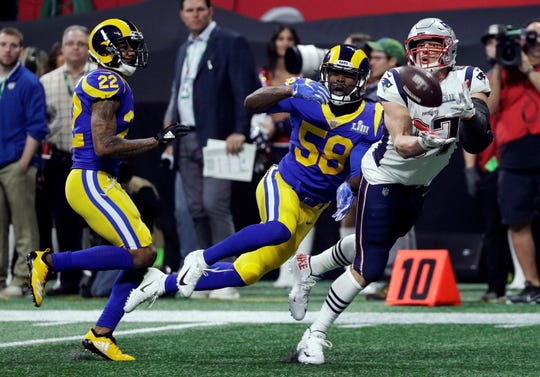 New England Patriots' Rob Gronkowski (87) catches a pass in front of Los Angeles Rams' Marcus Peters (22) and Cory Littleton (58) during the second half of the NFL Super Bowl 53 football game Sunday, Feb. 3, 2019, in Atlanta. (AP Photo/David J. Phillip)