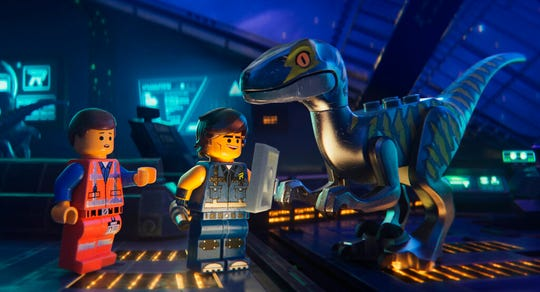 "Emmet, left, and Rex Dangervest, center, both voiced by Chris Pratt, in a scene from ""The Lego Movie 2: The Second Part."" The movie opens Feb. 7 at Regal West Manchester Stadium 13 and R/C Hanover Movies."