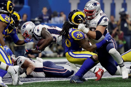 New England Patriots' Sony Michel dives for a touchdown during the second half of the NFL Super Bowl 53 football game against the Los Angeles Rams, Sunday, Feb. 3, 2019, in Atlanta. (AP Photo/Jeff Roberson)