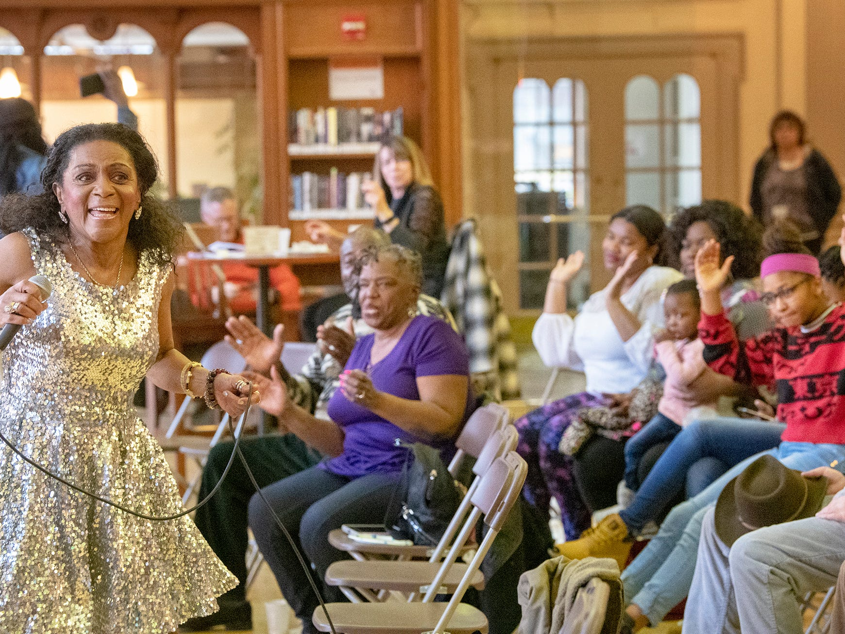 Vanda Guzman performs during a free concert at Martin Library recently. She spent 24 years abroad, but lives in York now, saying the city reminds her of the time she spent in Germany.
