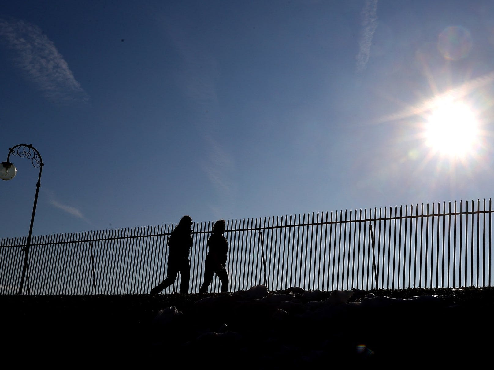 Joggers enjoy the warm weather Monday morning at Cobbs Hill.