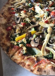 At Create A Pizza, you can load up your pizza with toppings.