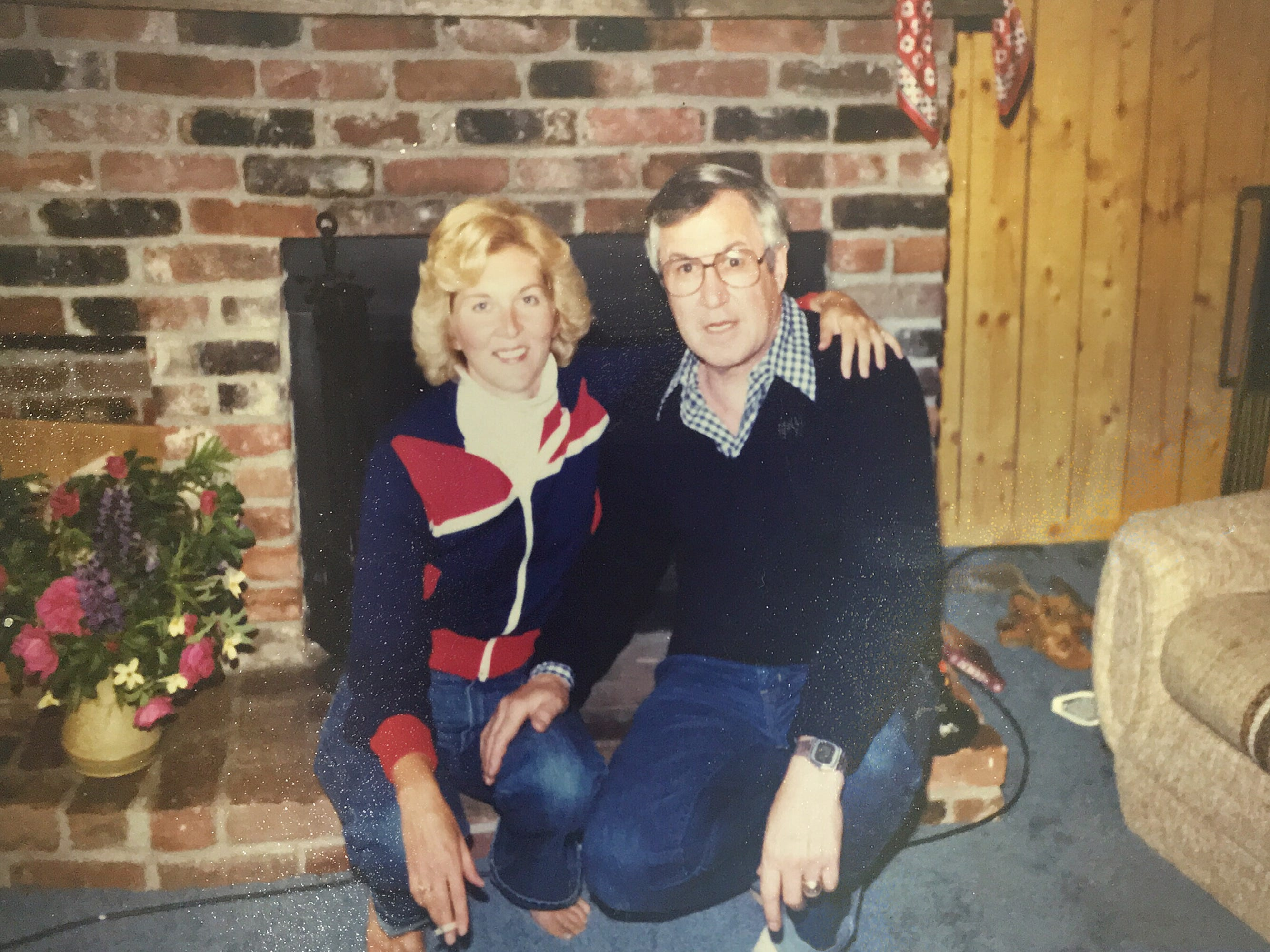 Bonnie and Joe Crozier pose in front of the fireplace at their home in Vancouver.