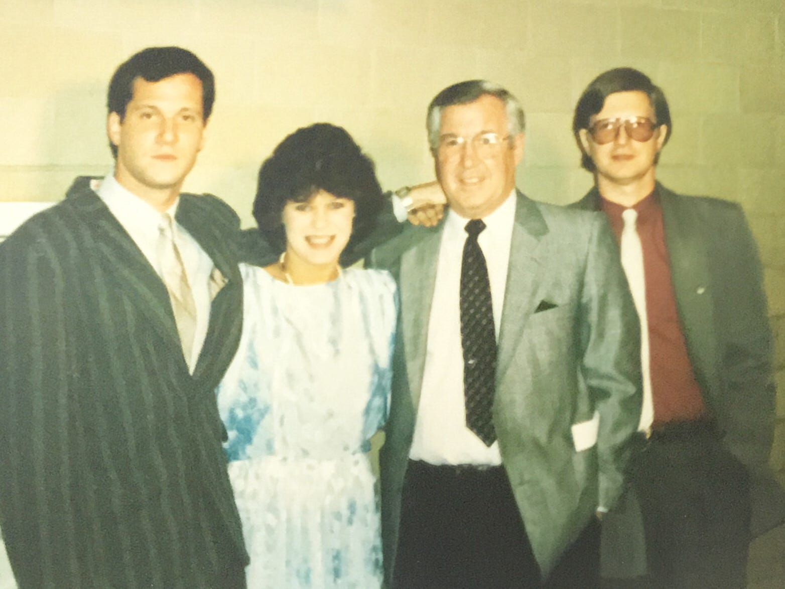 Joe Crozier, with children (left to right) Jamie, Erin, and Shayne from his first marriage in front of Joe's Amerks Hall of Fame display at the War Memorial. Crozier was part of inaugural class of 1986.