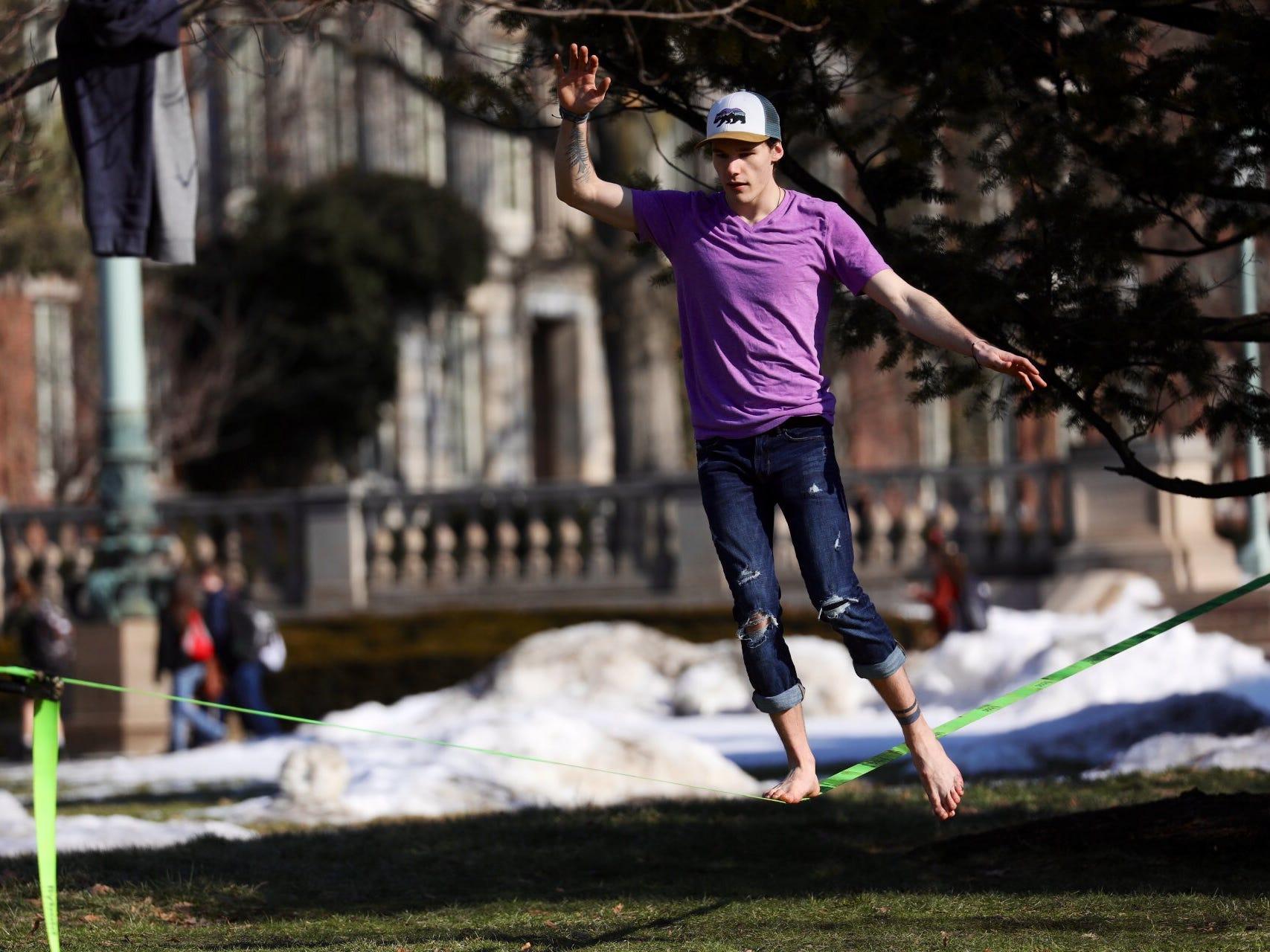 Joey Melena, a senior at the University of Rochester, enjoys the sun Monday.