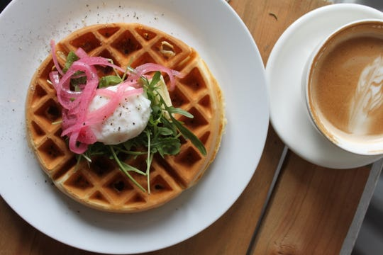 At The Common Cup in Amity the Savory Waffle has bacon the batter and it's served topped with arugula, pickled onion, and a poached egg. Pictured on Jan. 23, 2019.