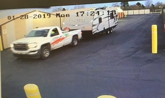 Police say two men stole a travel trailer from a Woodburn storage facility.