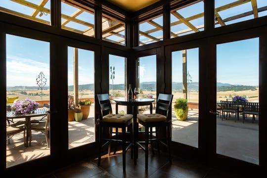 The tasting room at Van Duzer Vineyards has spectacular views of the valley below.