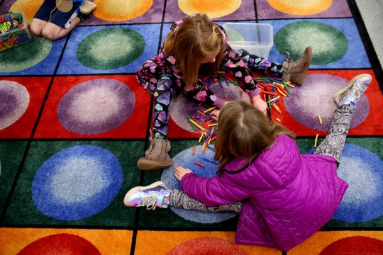 Students break off into different activity groups in a kindergarten classroom with 34 students, one teacher and one instructional assistant at Pringle Elementary School in Salem on Monday, Feb. 4, 2019.