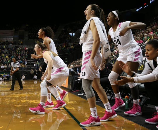 From front left to right, Oregon's Sabrina Ionescu, Satou Sabally, Maite Cazorla, Ruthy Hebard and Nyara Sabally cheer their team from the bench during the fourth quarter of an NCAA college basketball game against Colorado Sunday, Feb 3, 2019, in Eugene, Ore.