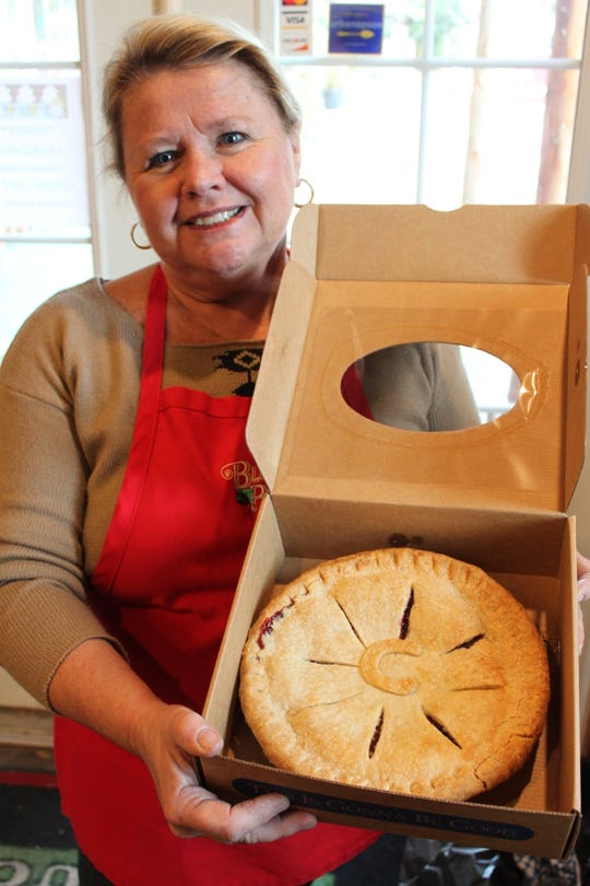 Owner Jamie Lewis holds a cherry pie at Blue Raeven Farmstand in Amity on National Pie Day, Jan. 23, 2019.
