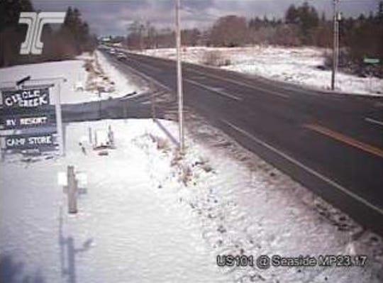 Snow accumulation in Seaside on Highway 101 near milepost 23.