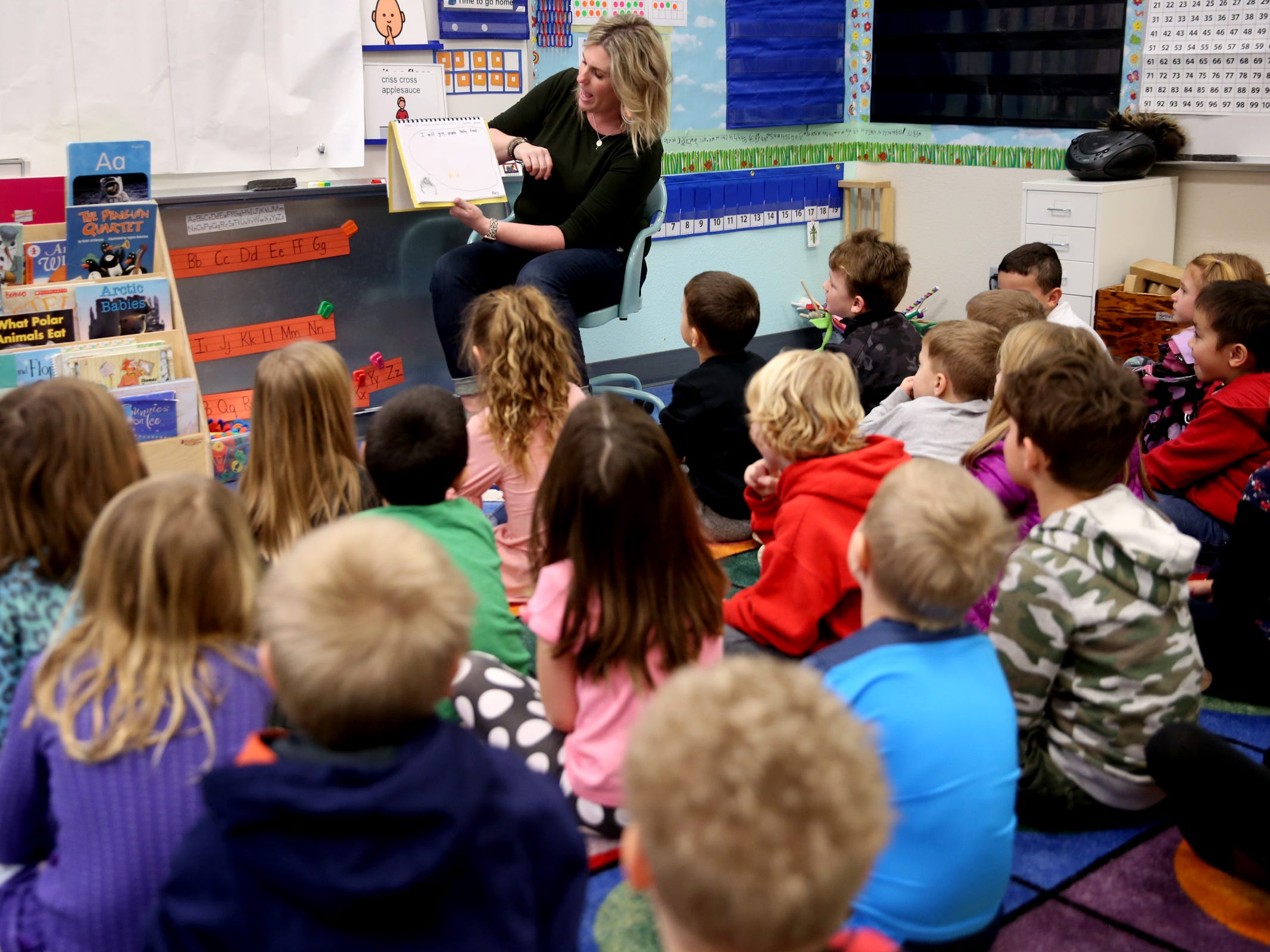 Teacher Jennifer Bethers reads to her kindergarten class with 34 students with one instructional assistant at Pringle Elementary School in Salem on Monday, Feb. 4, 2019.