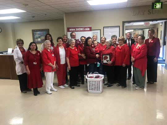 "San Angelo Community Medical Center honors Nancy Johnson with a plaque for her efforts with ""Little Hats, Big Hearts"" on Friday, Feb. 4."