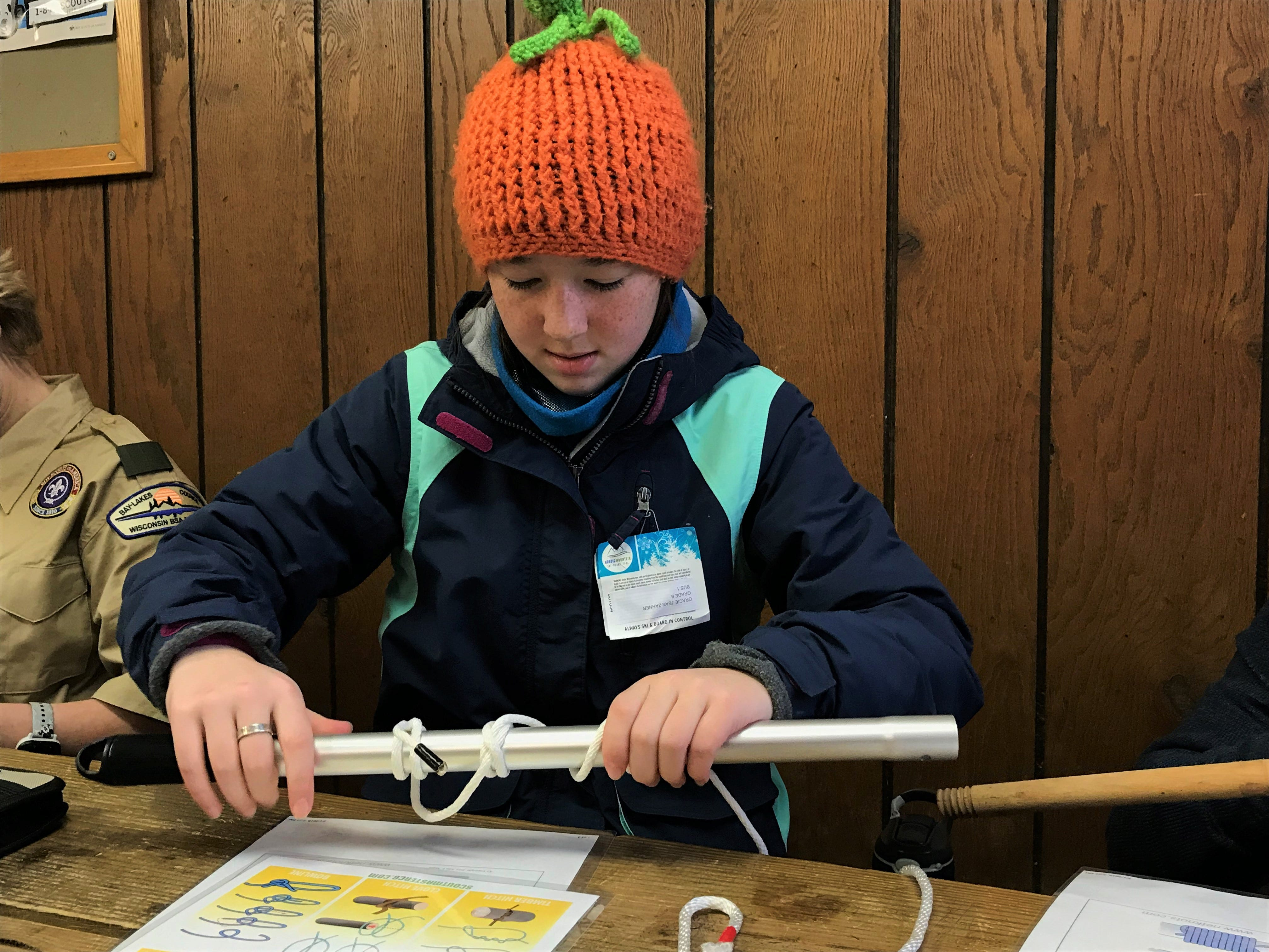 Gracie-Jean, 12 of Oshkosh perfects her Clove hitch on Saturday, Feb. 2 at Camp Rokilio as part of Scouts BSA.