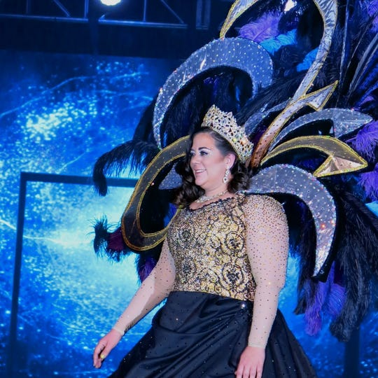 """Krewe Atlas Queen XI Emily Favrot presented to billows of smoke, haze and """"Rise Up"""" at the Atlas Grand Bal XI """"Age of Aquarius."""""""