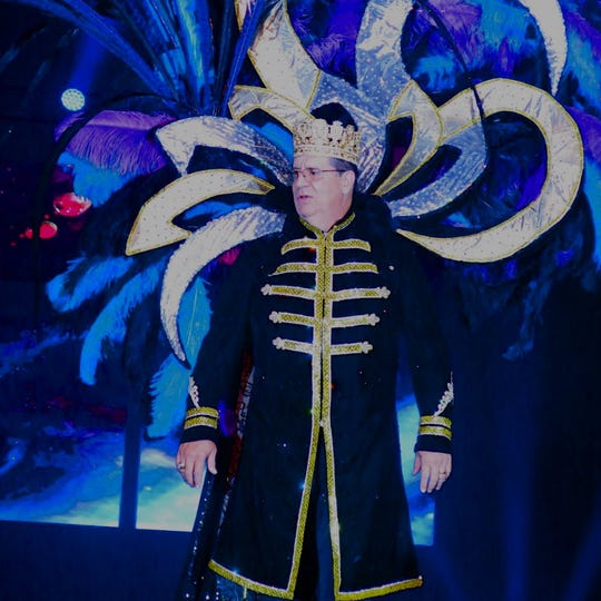 "Krewe Atlas King XI John Favrot is presented at Grande Bal XI ""Age of Aquarius""  as ""Bridge Over Troubled Water"" played."