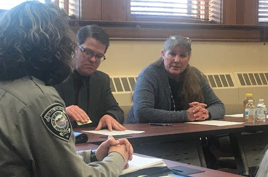 Councilor Theresa Stehly (right) discusses the possibility of legalizing beekeeping in the city of Sioux Falls with Animal Control Supervisor Julie DeJong (left) during a roundtable Monday afternoon at Carnegie Town Hall. City Council legislative assistant Jim David (middle) aided in the meeting.