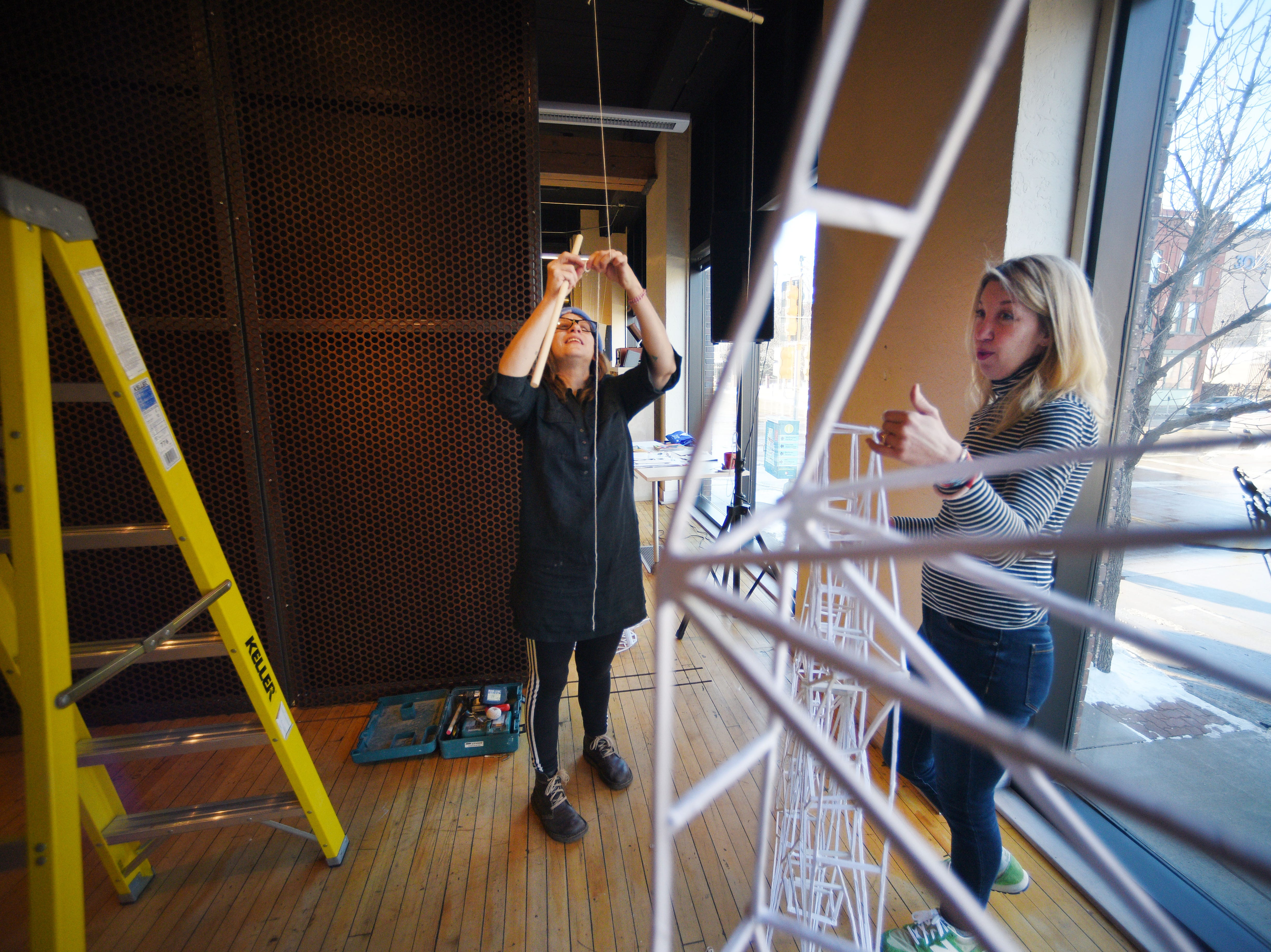 Working artist Amy Fill and gallery director Liz Heeren set up art installations for the upcoming Ipso gallery, Manualtronic, Saturday, Feb. 2, at Fresh Produce. The gallery is open Friday, Feb. 8, from 6 to 8 p.m. and will be up until the last Friday of March.
