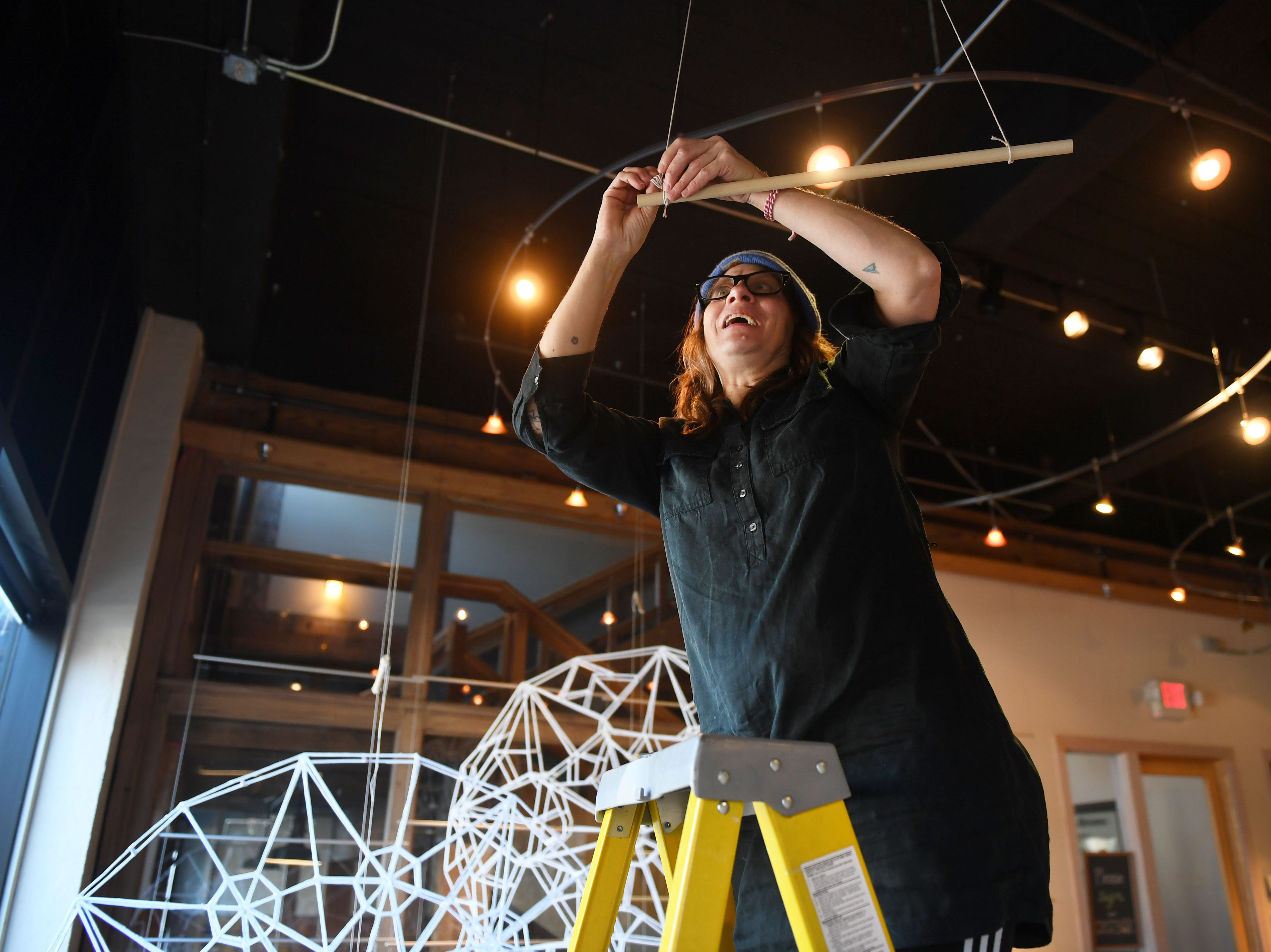 Working artists Amy Fill hangs string from the ceiling of Fresh Produce for her art installation in the upcoming Ipso gallery, Manualtronic, Saturday, Feb. 2, at Fresh Produce. The gallery is open Friday, Feb. 8, from 6 to 8 p.m. and will be up until the last Friday of March.