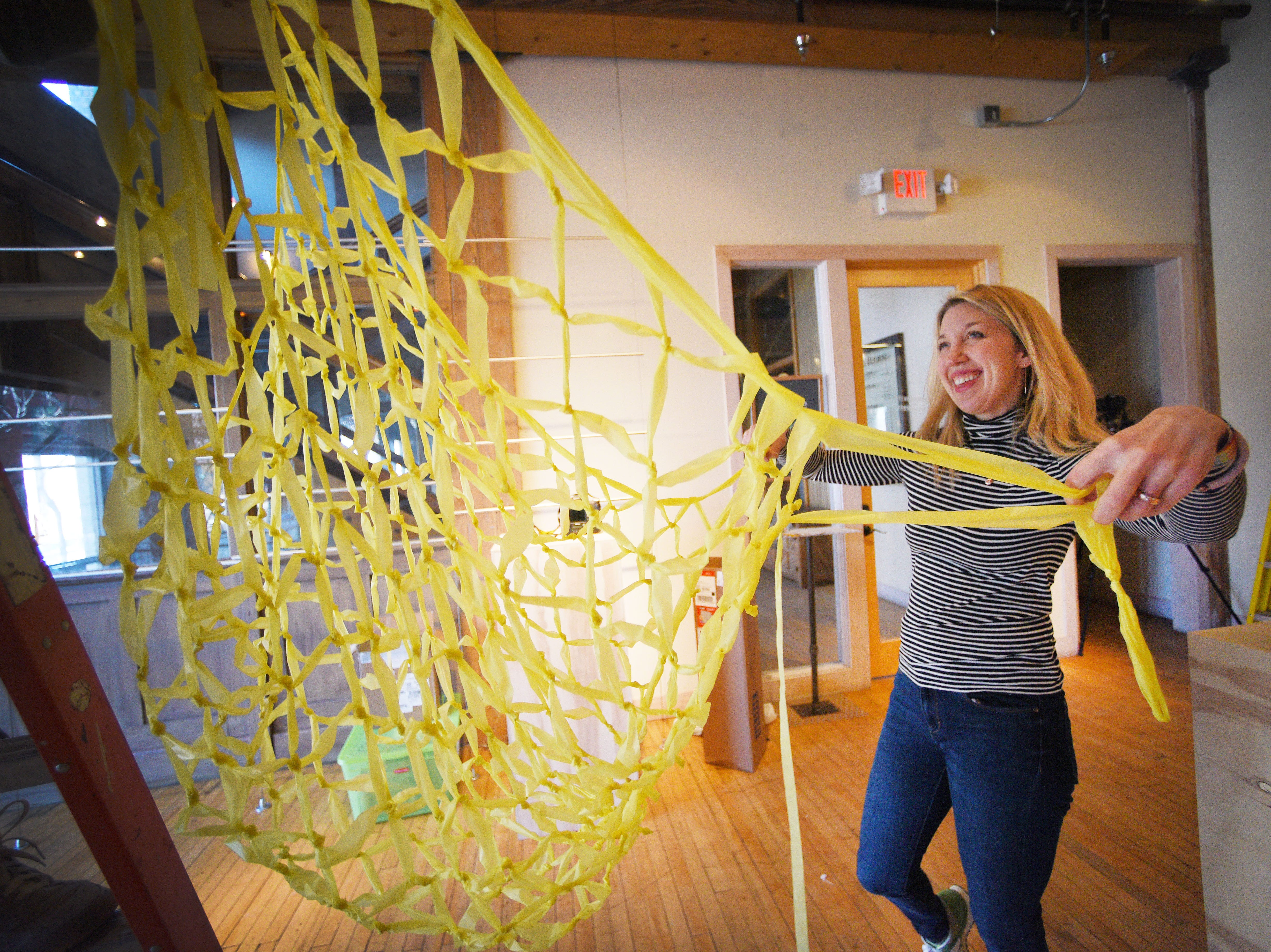 Gallery director Liz Heeren helps working artist and professor Jeff Ballard set up his art installations for the upcoming Ipso gallery, Manualtronic, Saturday, Feb. 2, at Fresh Produce. The gallery is open Friday, Feb. 8, from 6 to 8 p.m. and will be up until the last Friday of March.