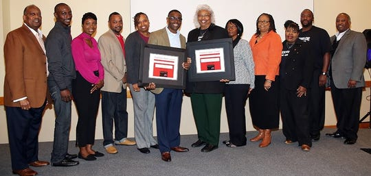 Pastor Darrick McGhee, Bible Based Church in Tallahassee (middle left), and Pastor Shirlean Thomas, Greenshade AME Church in Quincy (middle right), and their health leaders display plaques recognizing their churches for completion of the Health for Hearts United Program. Pastor Kennith Barrington, Metropolitan Cathedral of Truth in Havana (far left), and Pastor Tony Hannah, Greater St. James AME Church in Quincy (far right), who are members of the Health for Hearts United Pastors' Advisory Council, made the presentations on behalf of the program.