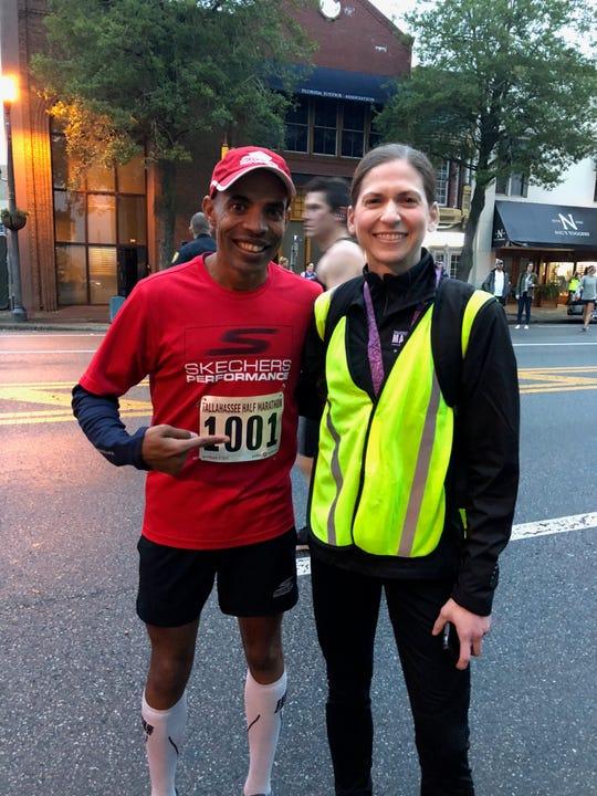 Runner Meb Keflezighi with Tallahassee Marathon director Sheryl Rosen.