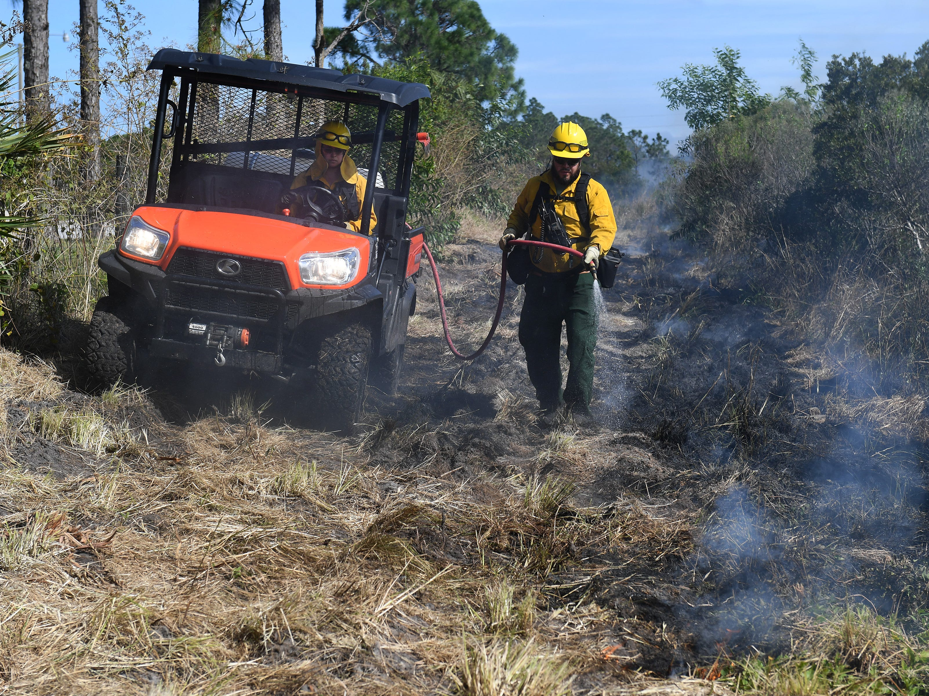 Florida Park Service ignites the brush at the Atlantic Ridge Preserve State Park during a planned one day prescribed burn on Monday, Feb. 4, 2019, in Hobe Sound. Twelve crew members of the Florida Park Service burned an area of approximately 180 acres of pine flatwoods south of Seabranch Boulevard to reduce the undergrowth and decrease the potential for future wildfire.