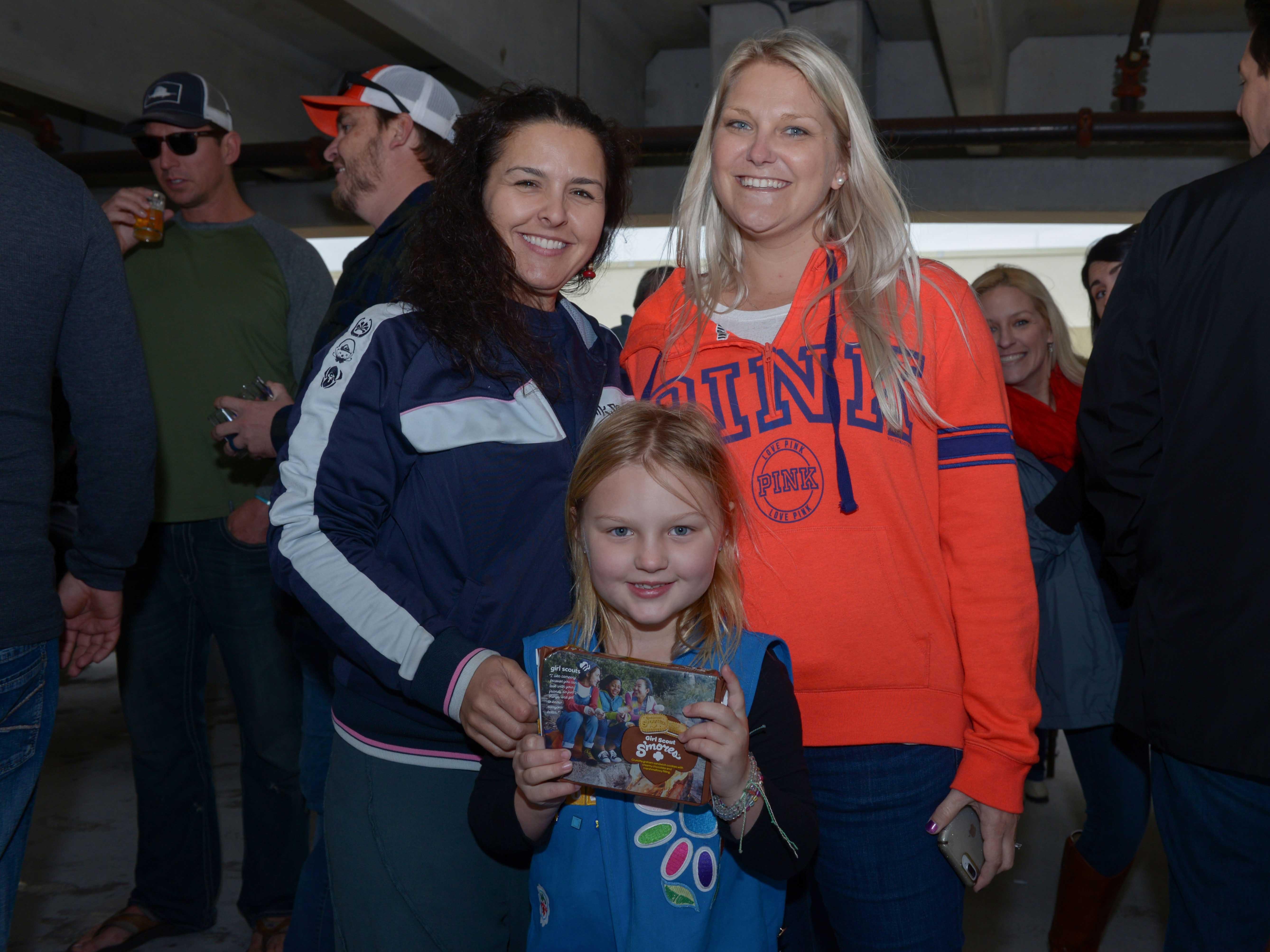 Krissy Gibbons, left, of Varsity Sports Shop, with Kate and Courtney Gibbons at Bluebird Educational Foundation's Groovin' & Tastin' Sunrise City Wine & Spirits Fest.